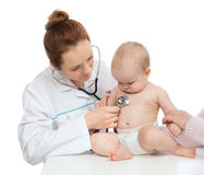 Doctor or nurse auscultating child baby patient heart with stethoscope