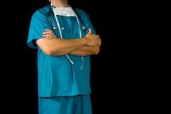 Doctor or nurse on black. Doctor or nurse in medical scrubs in front of black background Stock Image