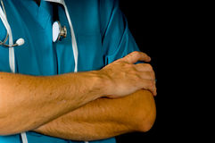 Doctor or nurse on black. Doctor or nurse in medical scrubs in front of black background Stock Photos