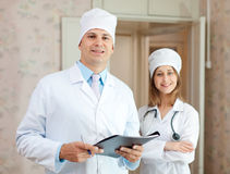 Doctor and nurse in clinic. Portrait of doctor and nurse in clinic interior. Focus on man Stock Photos