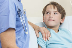 Doctor or Nurse Comforting Young Boy Child Patient Royalty Free Stock Photography