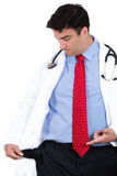Doctor or nurse or dentist with blue shirt, red tie, and stethoscope, pulling out empty pocket showing he is broke Stock Images