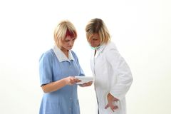 Doctor and nurse discusing what to do Royalty Free Stock Photo