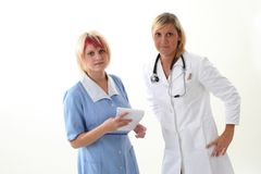 Doctor and nurse discusing what to do Stock Photo