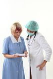 Doctor and nurse discusing what to do Stock Photography