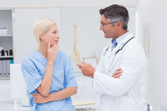 Doctor and nurse discussing in clinic Stock Image
