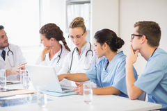 Doctor and nurse discussing over laptop Stock Image
