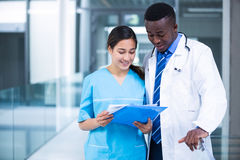 Doctor and nurse discussing over a report Royalty Free Stock Images
