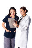 Doctor and Nurse discussing Patient medical chart Stock Image