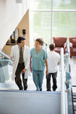 Doctor And Nurse Discussing While Walking On Royalty Free Stock Photo