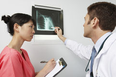 Doctor And Nurse Discussing X-Ray Results Stock Images