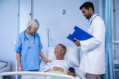 Doctor and nurse examining a patient Royalty Free Stock Photos