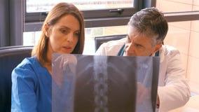 Doctor and nurse examining x-ray stock footage