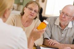 Doctor or Nurse Explaining Prescription Medicine t Stock Photos
