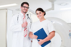 Doctor and nurse in front of CT scan machine. In diagnostics room of hospital Stock Images