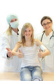 Doctor, nurse and girls keep the thumbs up Stock Photography