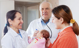 Doctor and nurse gives the healthy baby to mother Royalty Free Stock Photography
