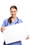 Doctor or nurse holding a blank placard Royalty Free Stock Image