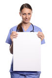 Doctor or nurse holding a blank placard Stock Photo