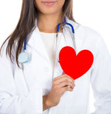 Doctor or nurse holding heart to heart Stock Images