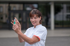 Doctor or nurse holding a hypodermic Stock Photo