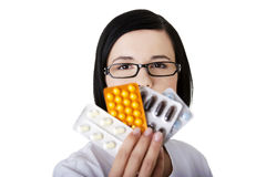 Doctor or nurse holding prescription drugs Stock Images
