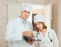 Doctor and nurse in hospital Stock Photos