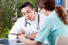 Doctor and nurse interpreting results Royalty Free Stock Photography