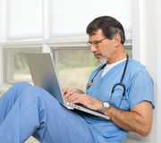 Doctor or Nurse with Laptop Computer Royalty Free Stock Photography