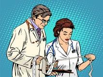 Doctor and nurse looking cardiogram Royalty Free Stock Photos