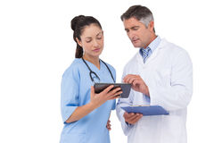 Doctor and nurse looking at clipboard Royalty Free Stock Image