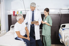 Doctor And Nurse Looking At Patient At Rehab Center Royalty Free Stock Images