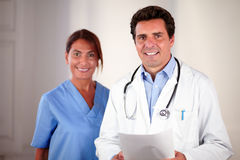 Doctor and nurse looking and smiling at you Royalty Free Stock Images