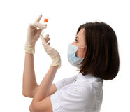 Doctor or nurse with with medical test tube vaccination concept Stock Photo