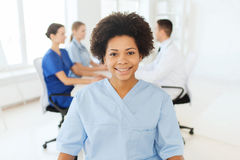 Doctor or nurse over group of medics at hospital Stock Photography