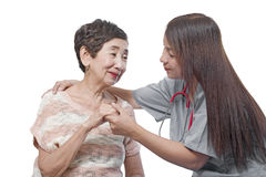 Doctor or Nurse And Patient. Doctor or nurse caring for an elderly patient. Isolated in white background Royalty Free Stock Image