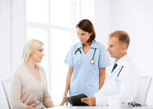 Doctor and nurse with patient in hospital Royalty Free Stock Photo