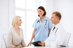 Doctor and nurse with patient in hospital Royalty Free Stock Image