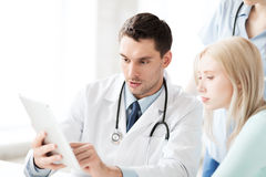 Doctor and nurse with patient in hospital stock photos