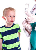 Doctor or nurse preparing injection of little boy. Royalty Free Stock Photos
