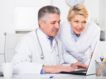 Doctor and nurse reading information Royalty Free Stock Images