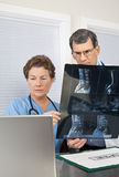 Doctor and Nurse Reading Spinal MRI Scan stock photography