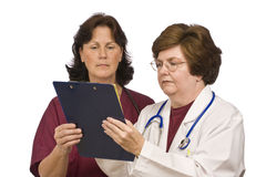 Doctor and Nurse Review Patient Records Stock Photos