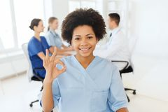 Doctor or nurse showing ok hand sign at hospital stock photos