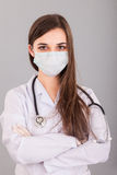 Doctor / nurse smiling behind surgeon mask. Closeup portrait of Royalty Free Stock Photography