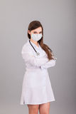 Doctor / nurse smiling behind surgeon mask. Closeup portrait of Stock Photo