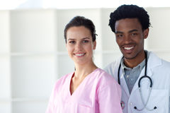 A doctor and a nurse smiling at the camera Stock Photography