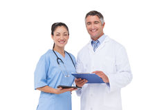 Doctor and nurse smiling at camera Stock Images