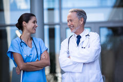 Doctor and nurse standing with arms crossed Royalty Free Stock Photos