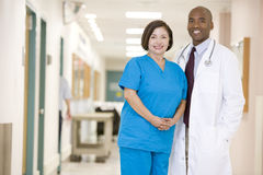 Doctor And Nurse Standing In A Hospital Corridor Stock Image